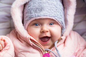 baby lachen, eerste glimlach