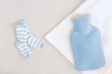 Een kruik voor je baby in bed: waarom en hoe?