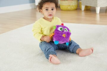 meisje met Giechel monster Fisher-Price